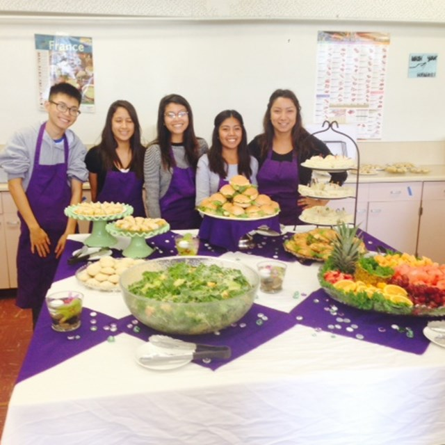 Santiago High School scholars prepare a healthy meal of fruits and vegetables.